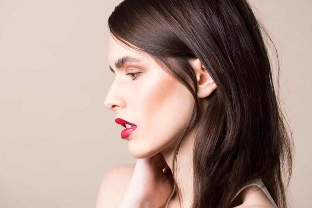 Photo: studio beauty cosmetics campaign photographer Margaret Yescombe, Make-Up Artist Hairstylist Dorota Nowacka, Model Elisabeth. Red lipstick, blusher, profile portrait image