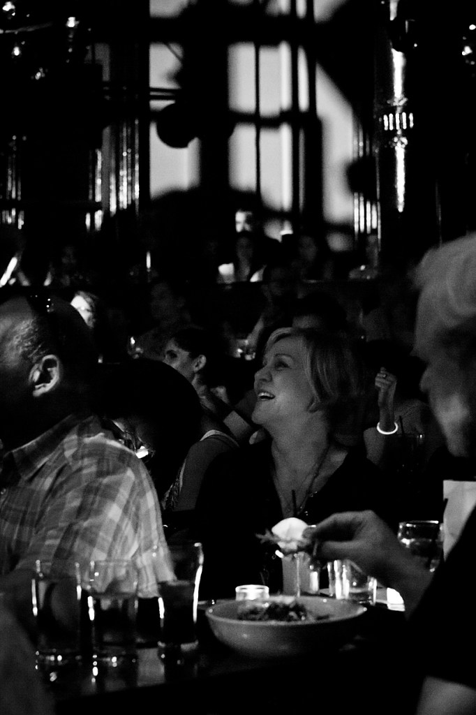Photo of seated audience enjoying performance
