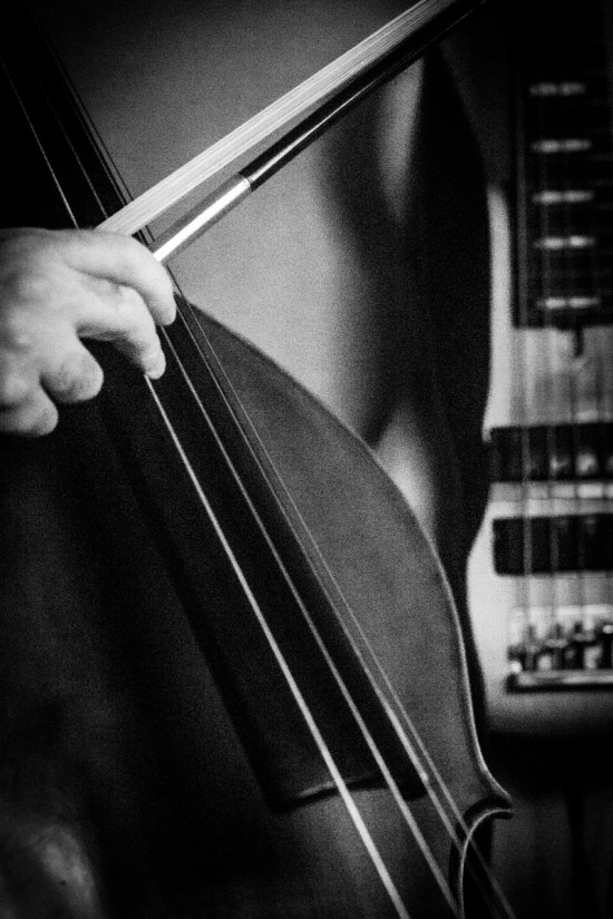 Photo: British female Photographer Margaret Yescombe, musician, bass player hand-bow-pluck-Matilda-Orchestra-Pit-Broadway, Shubert Theatre, NYC, New York