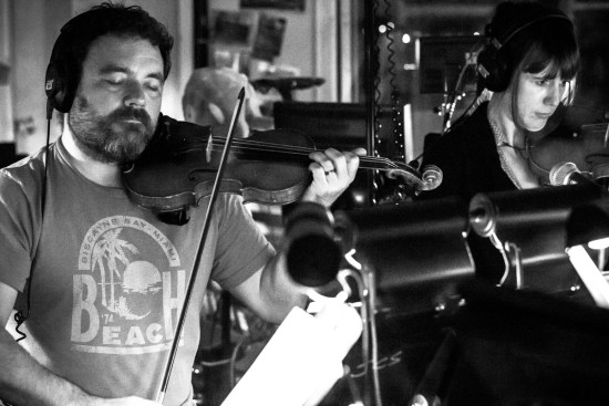 Photo: Photography by British photographer Maggie Yescombe from London, Photographer Margaret Yescombe, Matilda Orchestra Pit Broadway musician Jonny Dinklage playing violin