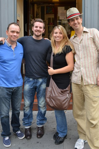 Mariah June at the stage door after the play Spamalot in West End, London, England, in 2012 with actors Todd Carty, Kit Orton, and Robin Armstrong