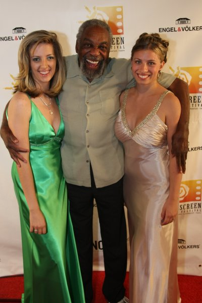 Mariah June standing with actor Bill Cobbs from Oz the Great and Powerful movie at the 2009 Sunscreen Film Festival in St. Petersburg, Florida
