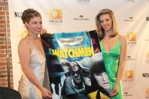Mariah June as trophy girl holding a Watchmen movie poster at the Sunscreen Film Festival in 2009 in St. Petersburg, Florida in a gold dress