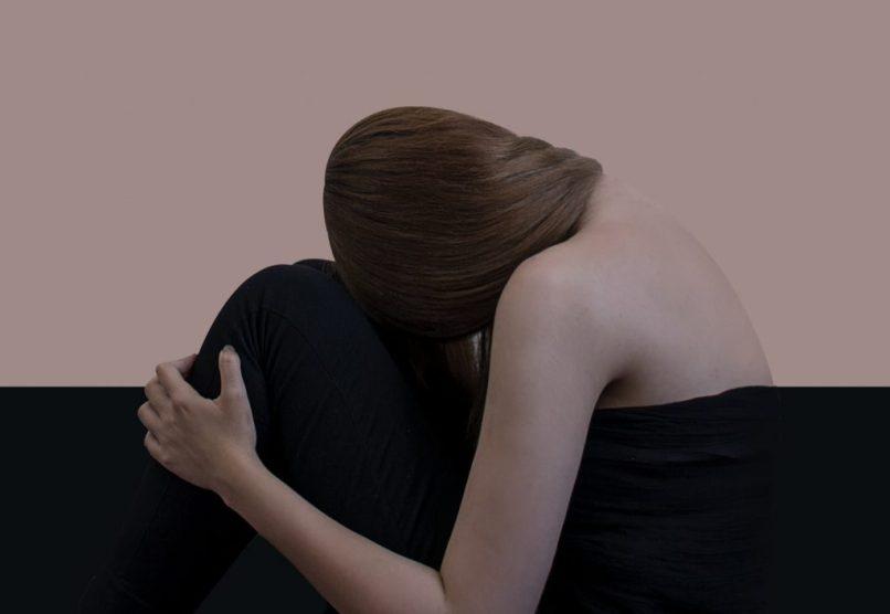 sad woman, emotional eating is a form of self-harm, Photo by Hadis Safari on Unsplash
