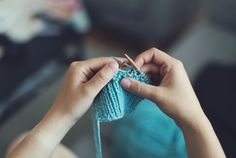 hands knitting: selling your crafts side hustles