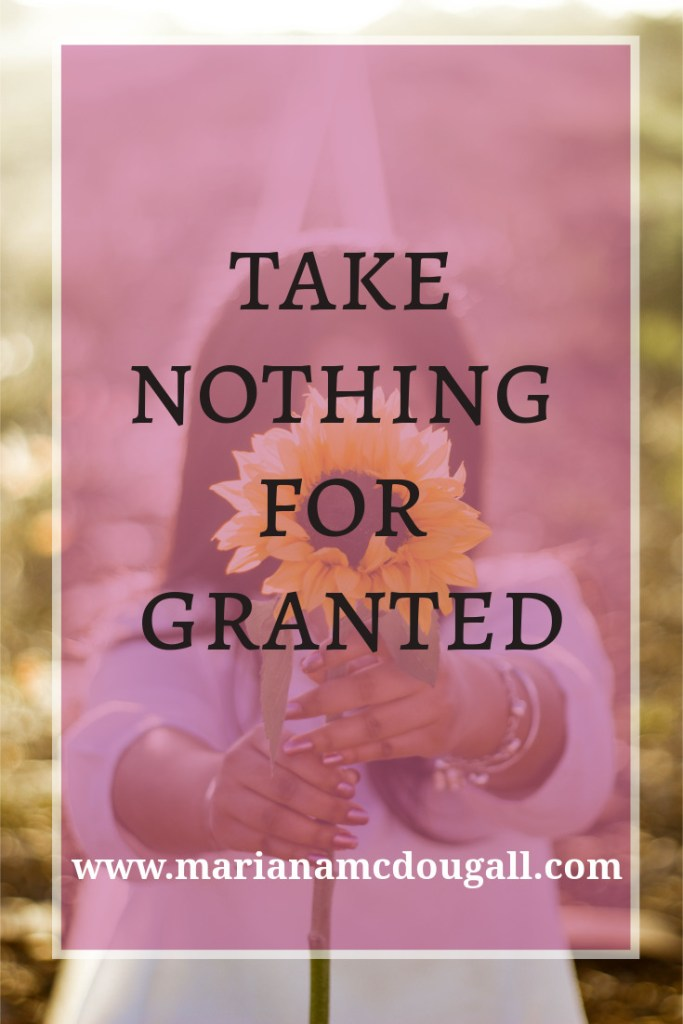 take nothing for granted, www.marianamcdougall.com, woman holding sunflower, Photo by Nicole Honeywill on Unsplash