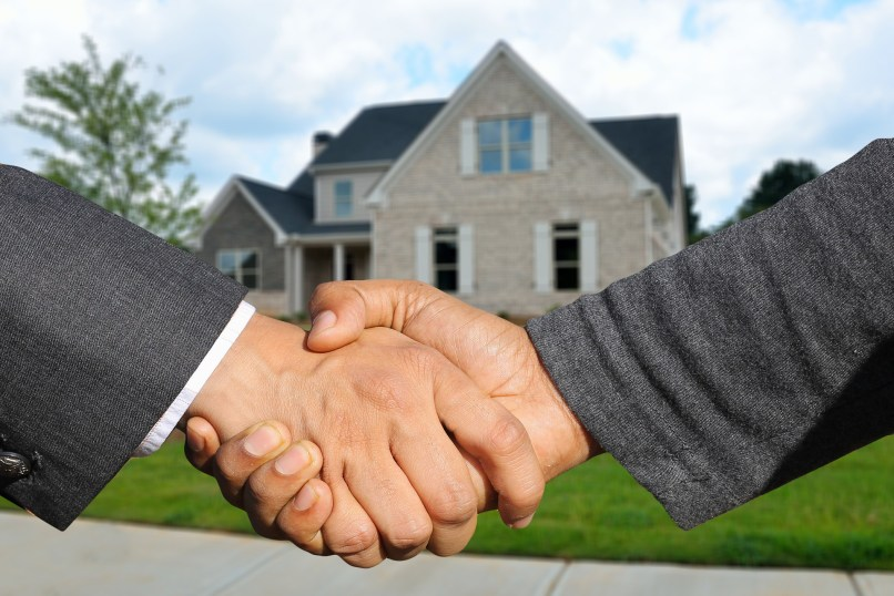real estate hand shake; property management