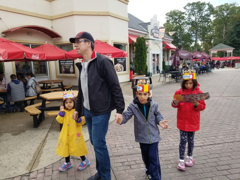 Father and three children walking at Six Flags Great Adventure, New Jersey