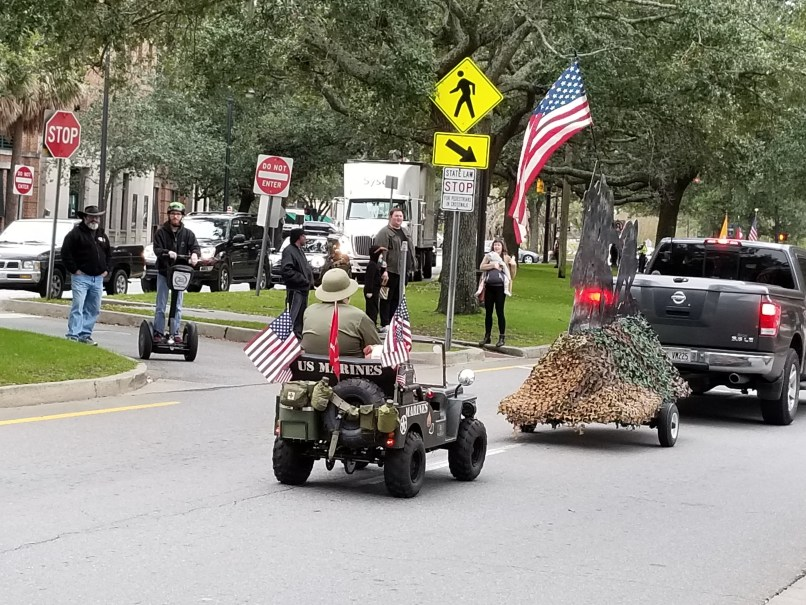 Man riding a U.S. Marine miniature jeep at Savannah's Veteran's Day Parade, 2018.