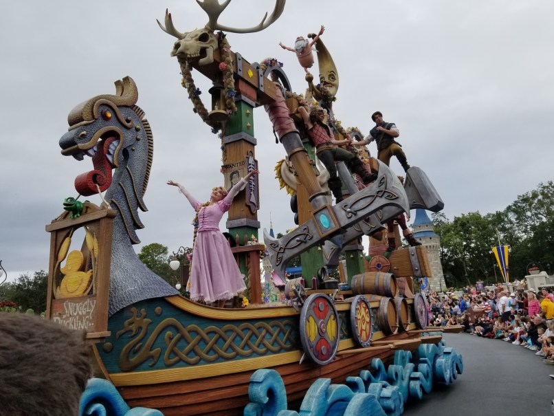 Rapunzel and Flynn Rider atop a float made to look like a boat, Magic Kingdom, Disney World