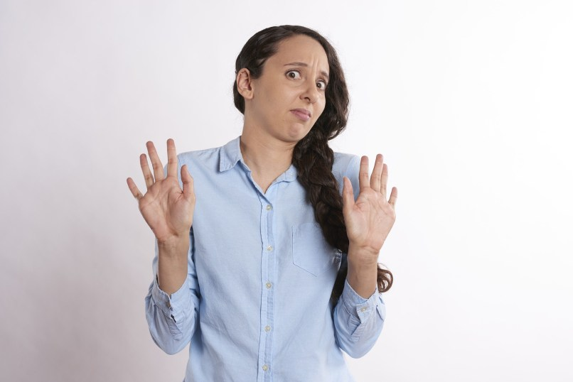 """Woman holding up hands in a """"nope"""" gesture"""