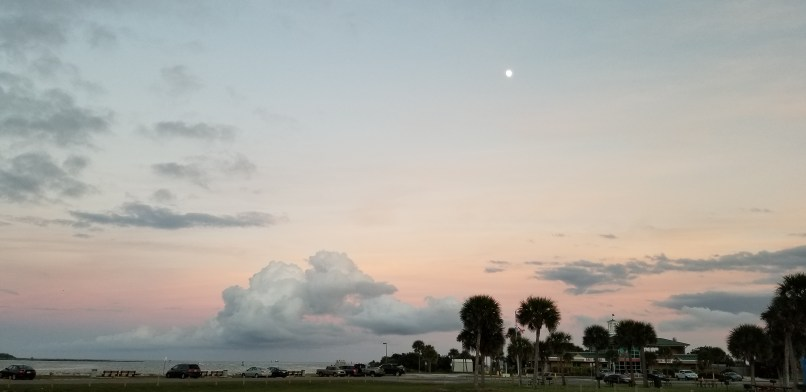 The moon as seen against a pinkish sky at Jetty Park Campground