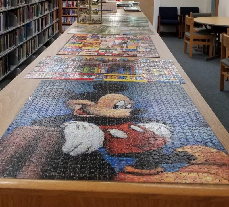 Completed Mickey mouse puzzle on top of a bookshelf at Wakulla County Public Library, Florida