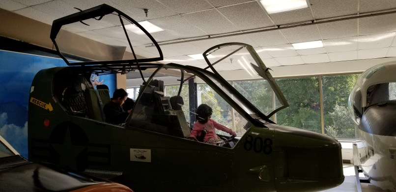 Children sitting in an airplane at the Naval Aviation Museum in Pensacola, Florida