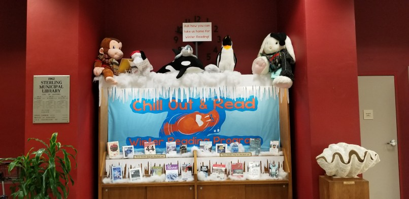 """Winter Reading Program Display at Sterling Public Library in Baytown, Texas. Books, stuffed animals, and a sign that says """"chill out and read."""""""