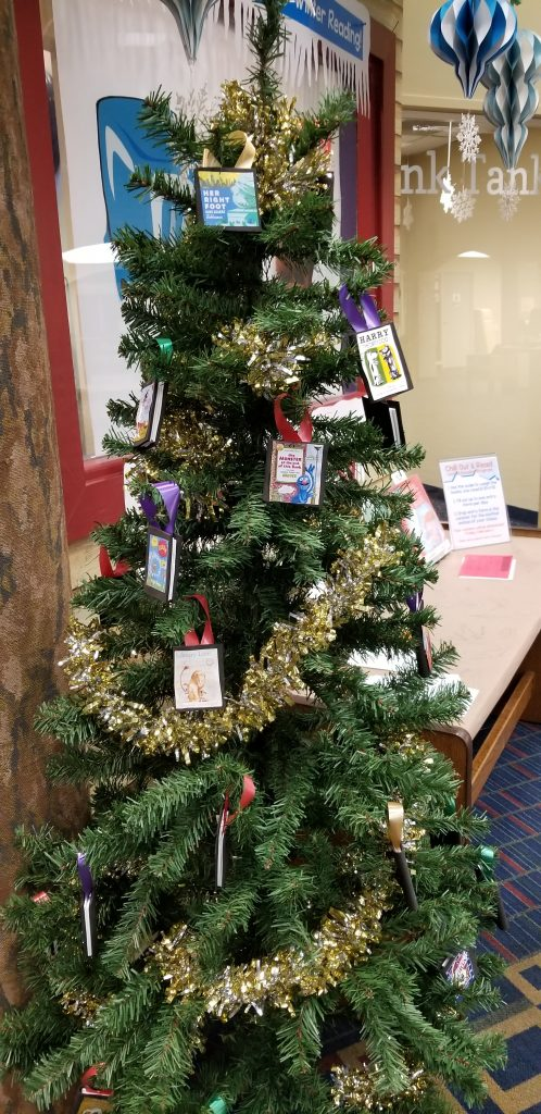Christmas tree decorated with mini-book ornaments. Kid Zone of Sterling Public Library in Baytown, Texas