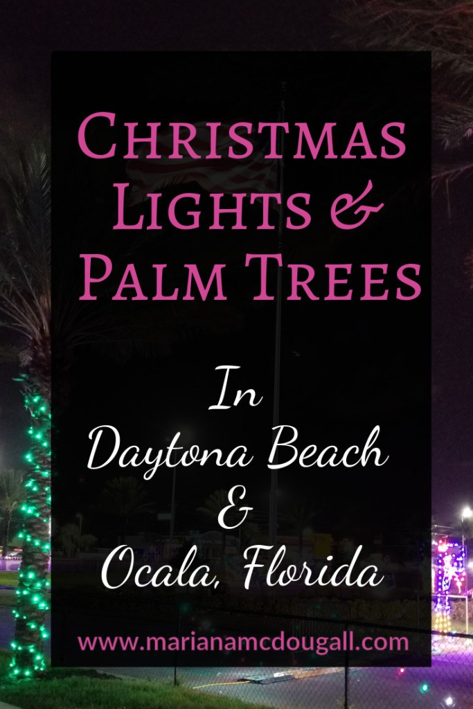 Christmas Lights & Palm Trees in Daytona Beach and Ocala, Florida, www.marianamcdougall.com. Picture of American flag, palm trees, and Christmas lights in front of Daytona International Speedway