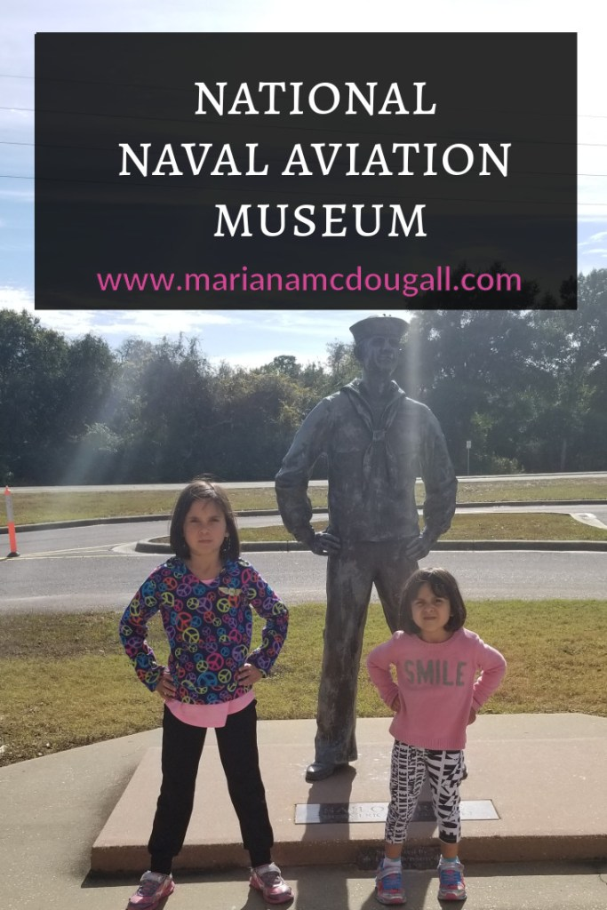 Naval Aviation Museum, www.marianamcdougall.com. Two girls stand in front of a statue outside the National Naval Aviation Museum in Pensacola, Florida.