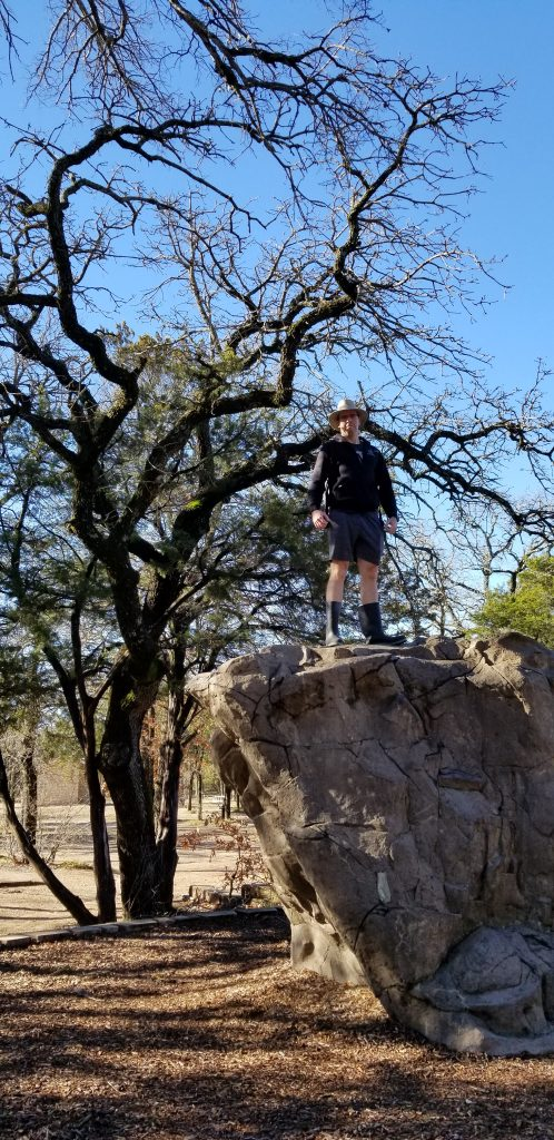 Man standing on a rock at Dinosaur Valley State Park