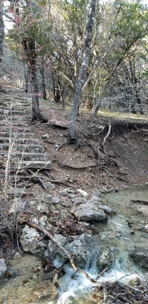 Meridian State Park, Texas. A set of stone steps above a brook.