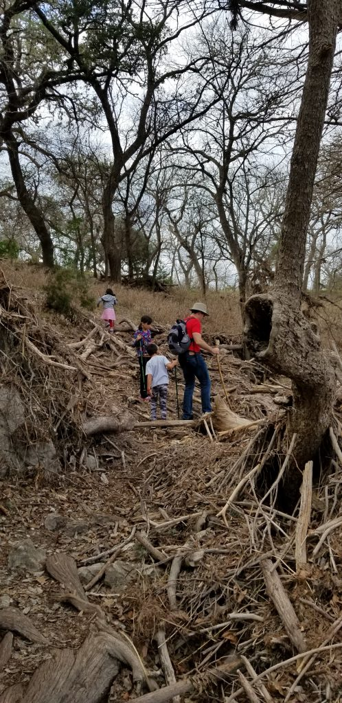 Father and three children hiking at Garner State Park. Photo by Mariana Abeid-McDougall on www.marianamcdougall.com