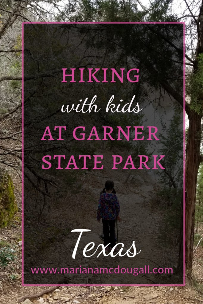 Hiking with kids at Garner State Park, Texas, www.marianamcdougall.com. Photo of girl in piggie tails hiking on a trail. Photo by Mariana Abeid-McDougall on www.marianamcdougall.com