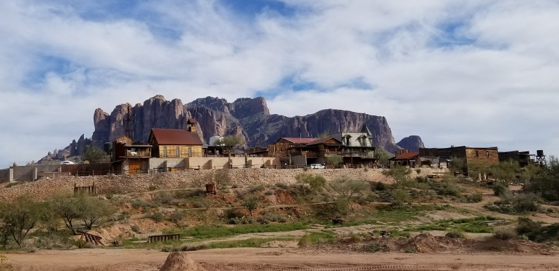 Goldfield Ghost Town. Several 1800s-style buildings stand in front of the Superstition Mountains in Goldfield Ghost Town, Apache Junction, Arizona