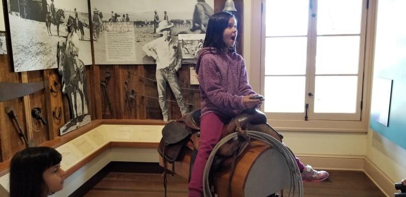 girl on saddle at Mojave National Preserve Kelso Depot Visitor Center