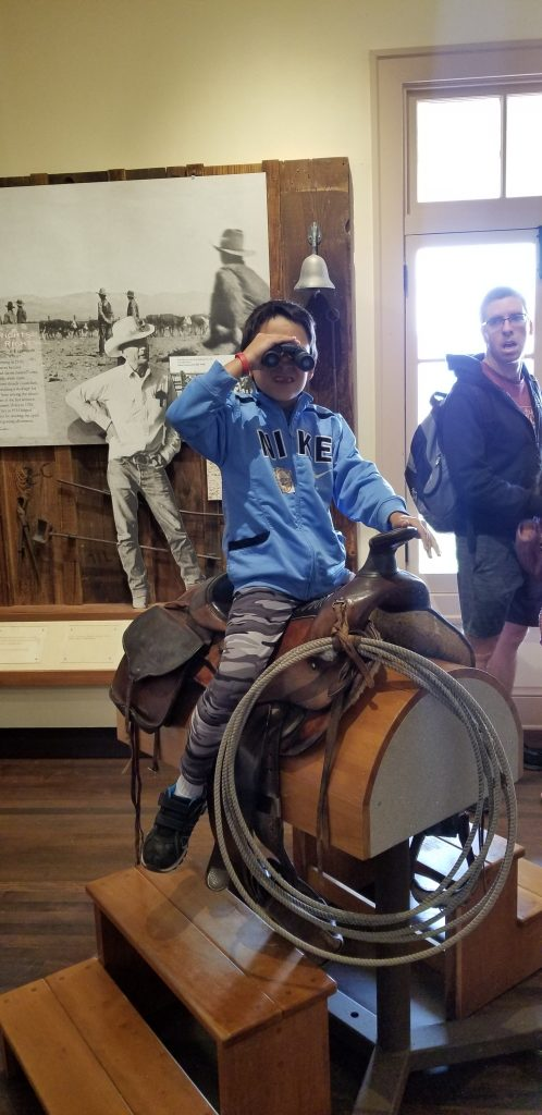 boy on saddle at Mojave National Preserve Kelso Depot Visitor Center