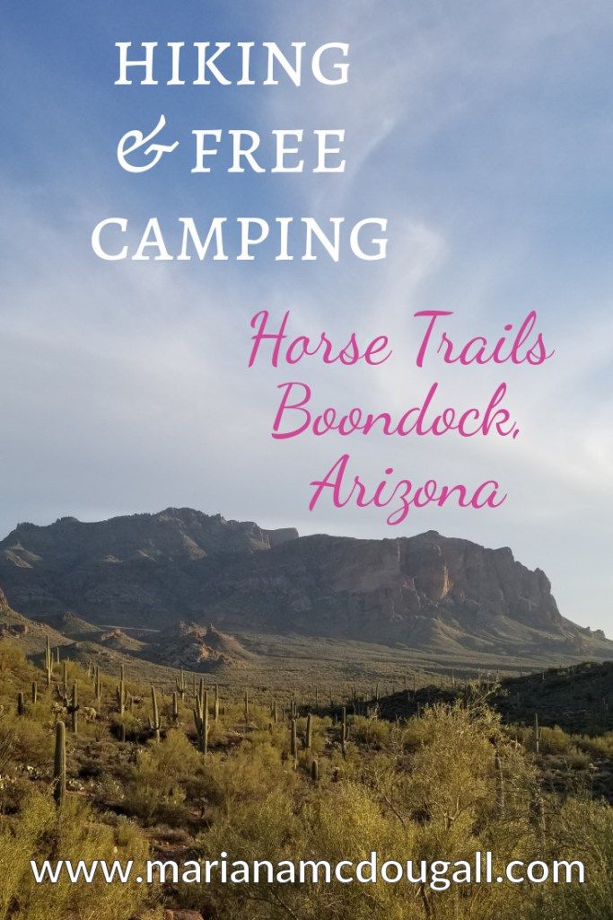 Pinterest Title Image. White and pink letters read: Hiking & Free Camping, Horse Trails Boondock, Arizona, www.marianamdougall.com. Background photo by Mariana Abeid-McDougall shows mountains in the distance, and several saguaro cactus in front of the mountain.