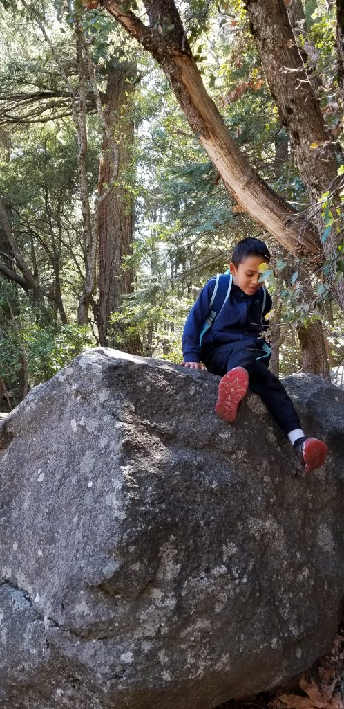 6-year-old boy sitting on a rock at Yosemite National Park
