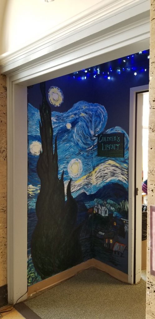 Butte Childrens Library entrance. A mural of Van Goghs Starry night is painted on the wall.