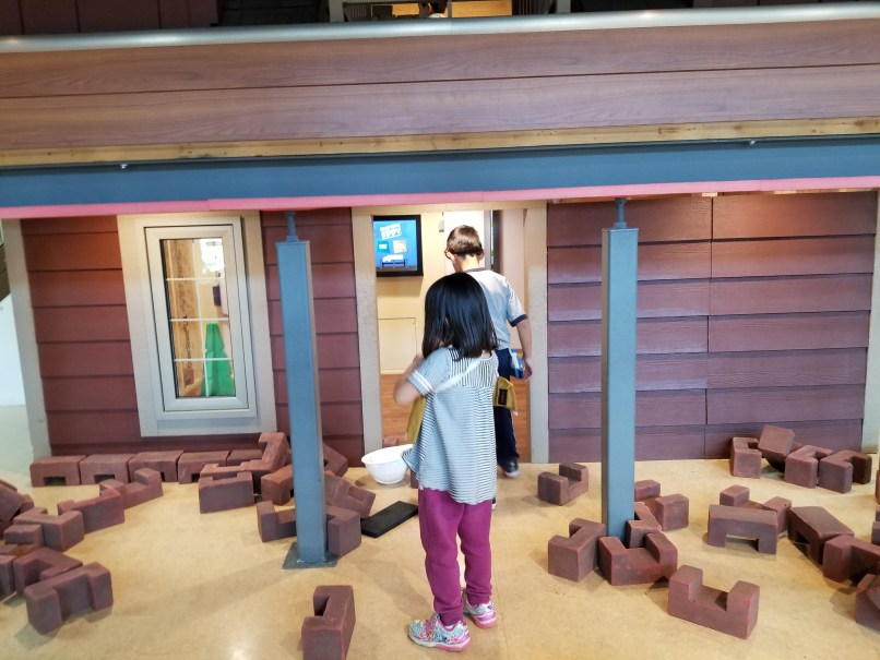 4-year-old girl and 6-year-old house playing in the construction house at Saskatchewan Science Centre