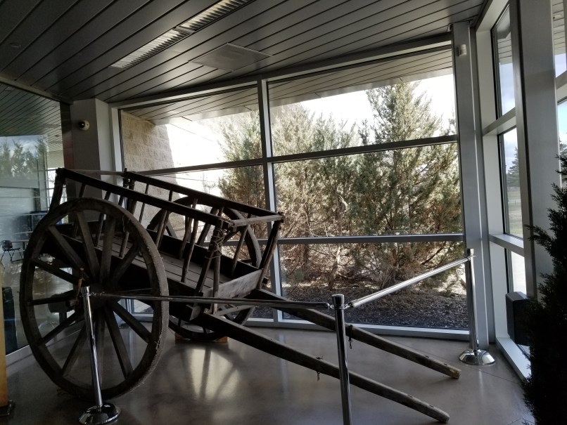 horse cart at the entrance of the RCMP Heritage Centre. No horses with the cart.