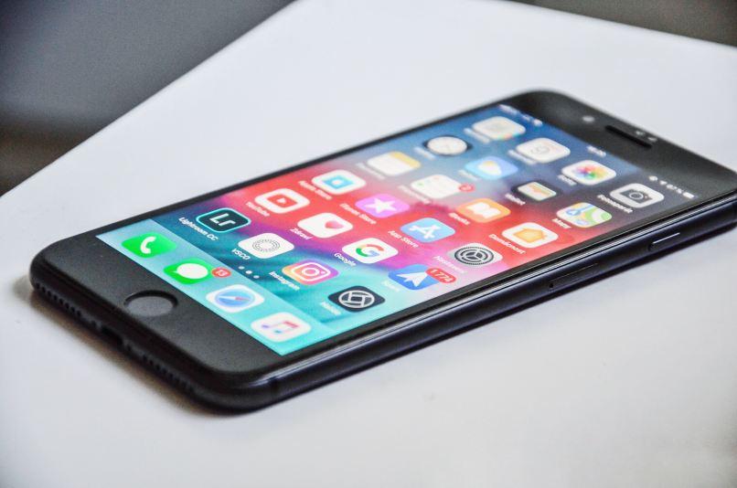 cell phone showing apps, Photo by David Švihovec on Unsplash
