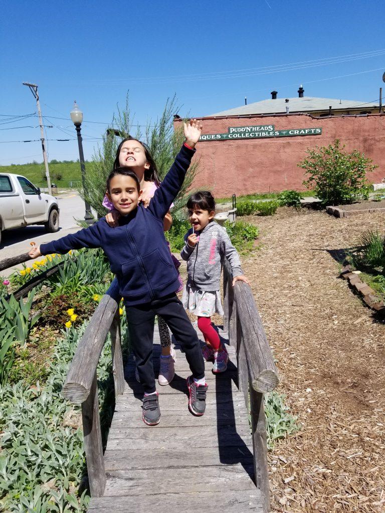 Three children on a little bridge