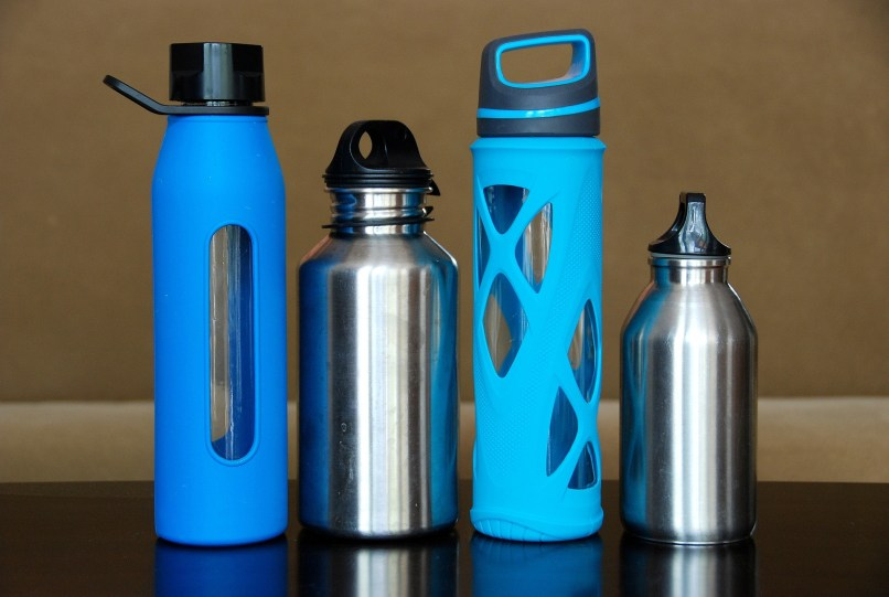 stainless steel and glass water bottles with silicone protectors. Photo by evitaochel on Pixabay