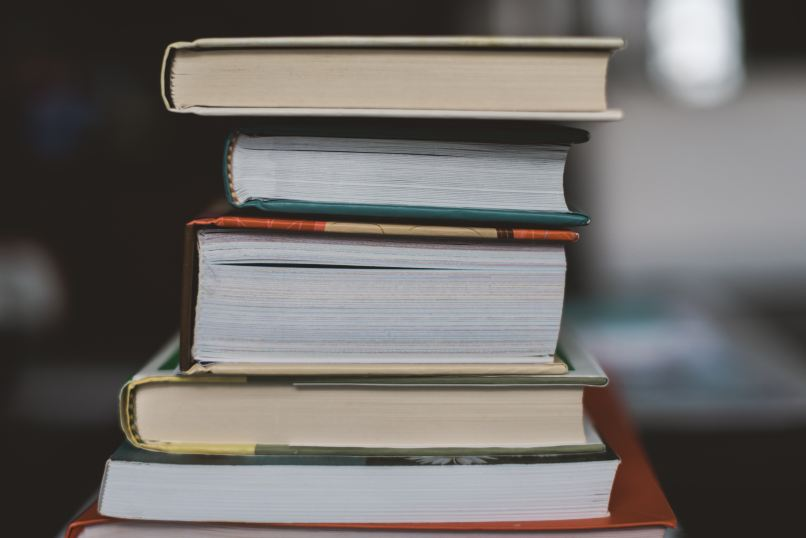 stack of books. Photo by Claudia on Unsplash