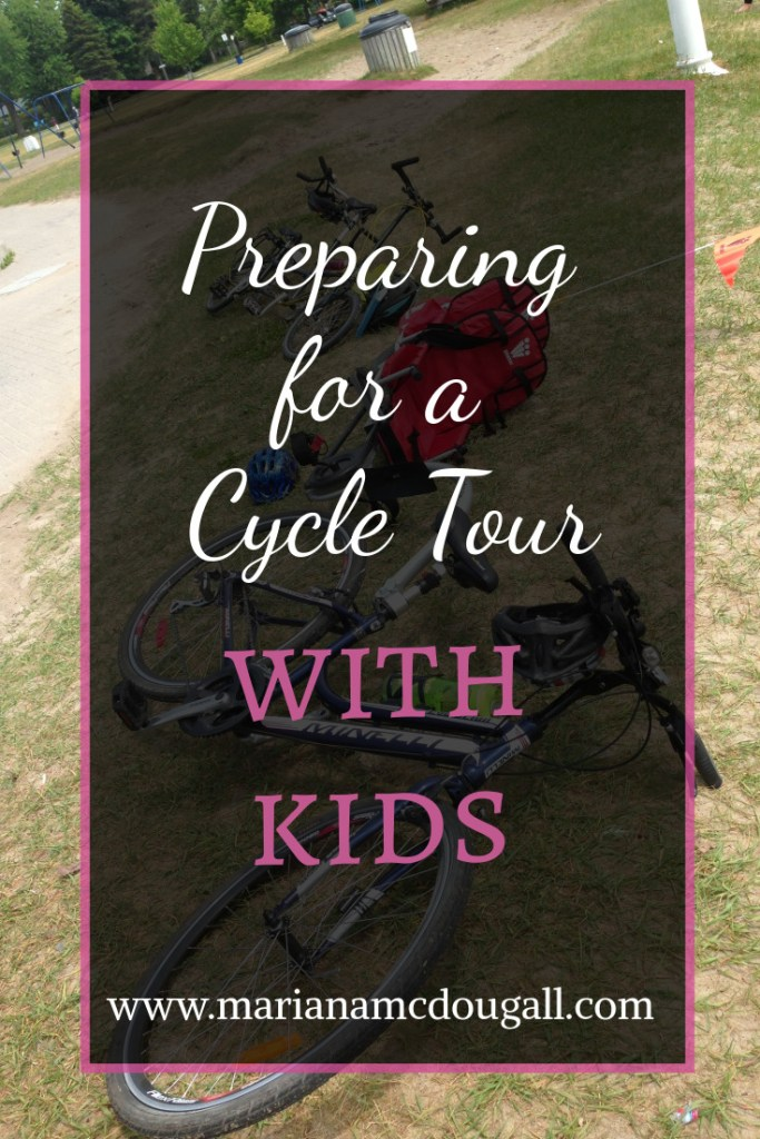 Preparing for a cycle tour with kids, www.marianamcdougall.com. Background photo of a bike set up for pulling a kids' trailer.