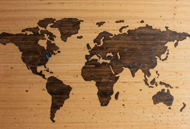 world map etched on a wooden board. Photo by Brett Zeck on Unsplash