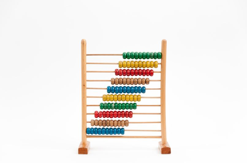 colourful standing abacus. Photo by Crissy Jarvis on Unsplash