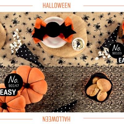 Edderkopper og flaggermus på kreativt festbord til Halloween