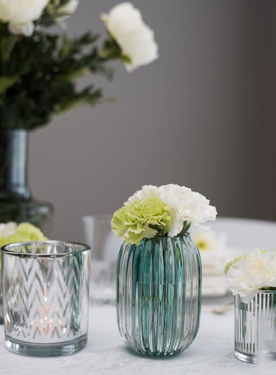 table setting in white, silver and green