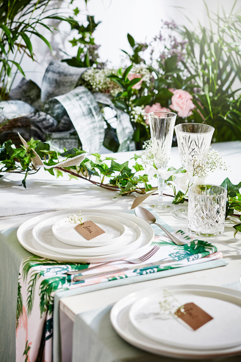 summer table setting with green plants