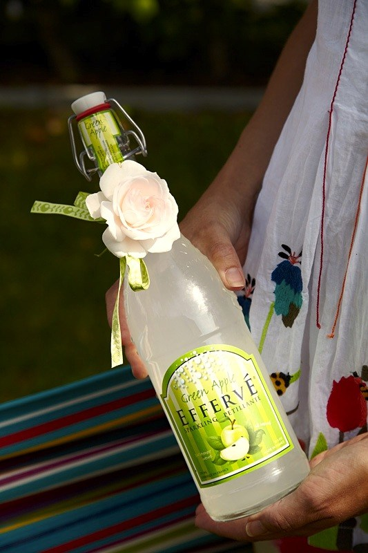 Decorated bottle as gift for the hostess