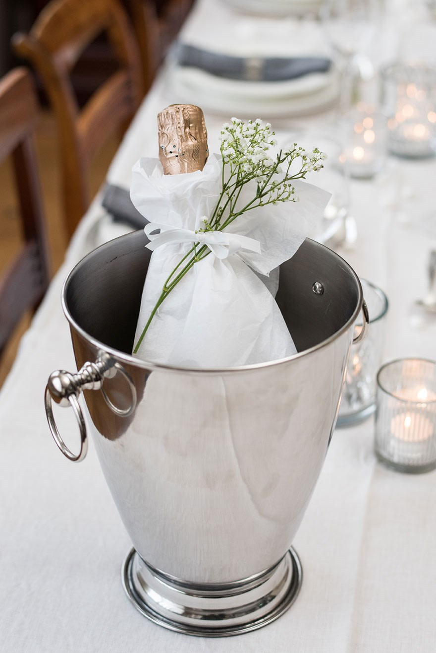 Decorative champagne bottle on the table