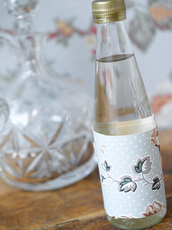 Bottle decorated with wallpaper