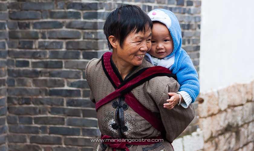 Chine, population dans la vieille ville de Lijiang, Yunnan © Marie-Ange Ostré