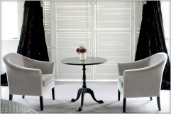 Designer Furniture : Belgravia tub chairs and bespoke table at Marie Charnley Interiors