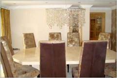 Designer Furniture : Stone International bespoke table with leather chairs at Marie Charnley Interiors